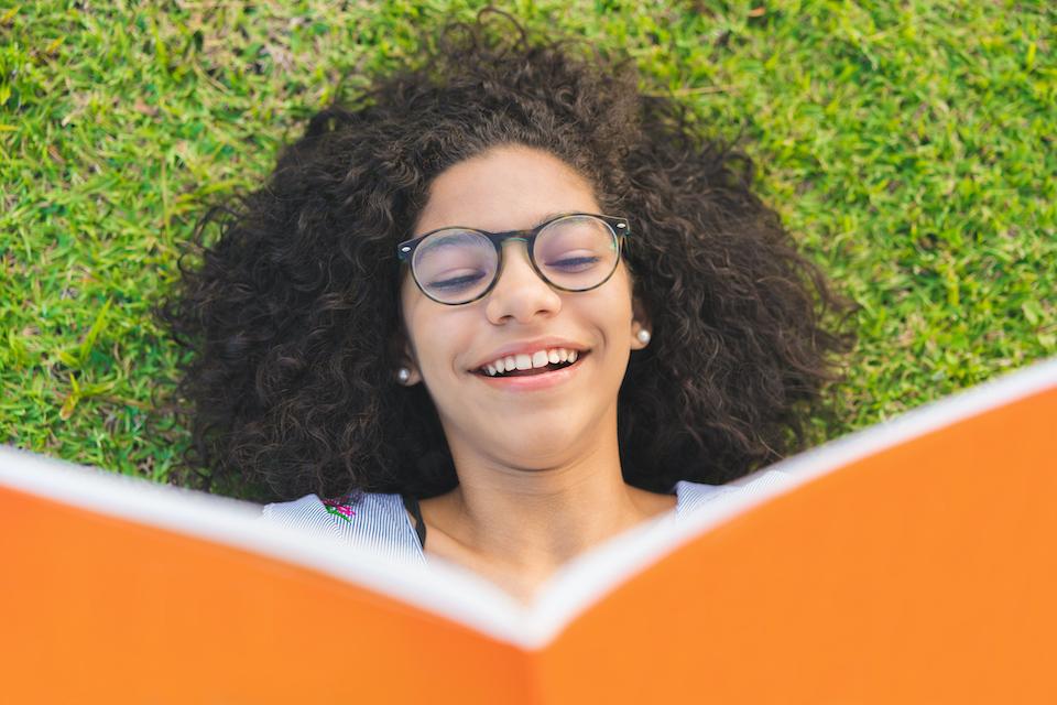girl reading summer program