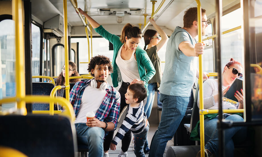 Parent struggling with time management on bus ride commute.
