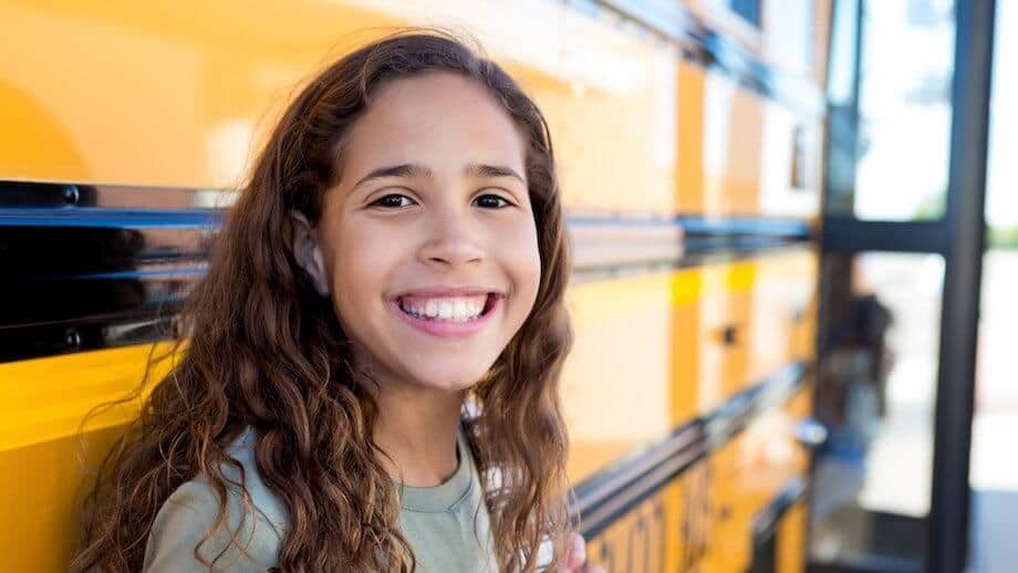 Middle school age student smiling and managing behavioral changes.