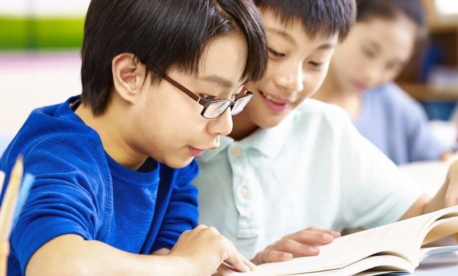 Students reading in class within Korean school system.